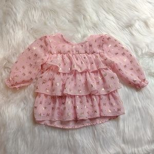 Pink ruffled light weight pink shirt with gold bow